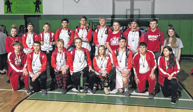 Members of the Wahama wrestling team pose for a picture after winning the 2019 Huntington Invitational championship trophy on Saturday in Chillicothe, Ohio.