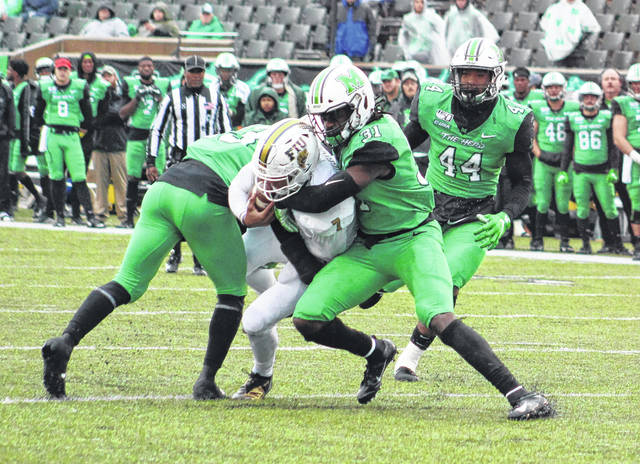 Marshall linebacker Omari Cobb (31) wraps up a Florida International ball carrier during the third quarter of Saturday afternoon's regular season finale at Joan C. Edwards Stadium in Huntington, W.Va.