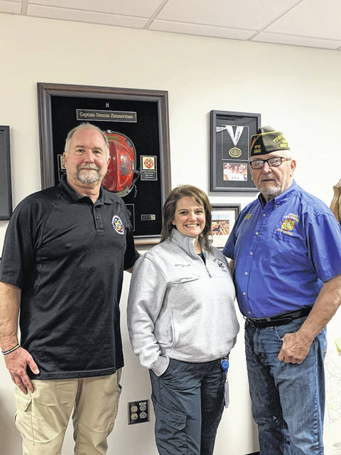 "Elisabeth Lloyd, center, has been chosen as the ""EMT of the Year"" by the Stewart-Johnson V.F.W. Post 9926 of Mason. She is pictured with Dennis Zimmerman, left, director of Mason County Division of Homeland Security and Emergency Management, and V.F.W. Commander Ray Varian."