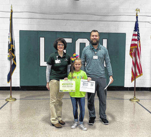 Leon Elementary fourth grade student, Berklee Bonecutter, was named the top student in the Get Up and Go competition after logging 189 miles. Pictured with Bonecutter are Amy Mullins and Gabe Roush with PVH.