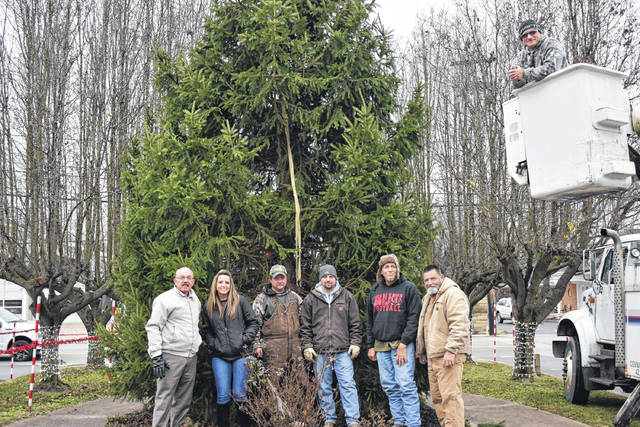 Point Pleasant's official city Christmas tree arrived at Gunn Park on Tuesday. The tree was freshly cut from Rawson Farm earlier in the day. Street department employees are pictured with Street Commissioner Randy Hall, Mayor Brian Billings and City Clerk Amber Tatterson. The tree will be lit following the city's annual Christmas parade this Friday - the parade begins at 6 p.m. with the tree lighting ceremony to immediately follow. Street Department Employee Butch Bonecutter, pictured fifth from left, had previously told the Register it typically takes two, five-gallon buckets of water, at least three times a week, to keep the city's tree watered through the Christmas season.