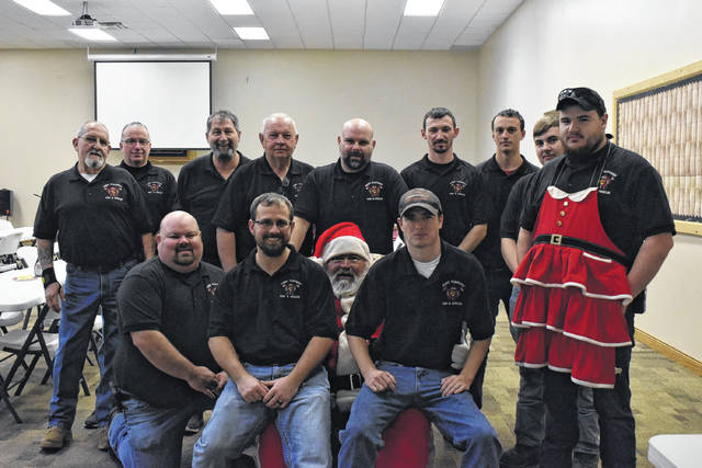 "The Point Pleasant Fire Department hosted their first ""Breakfast with Santa"" event on Saturday, Dec. 7 at the New Hope Bible Baptist Church. The department accepted donations during the event, but it was open to the public to have a warm breakfast, fellowship and to visit with Santa. Pictured are members of the department with Santa."