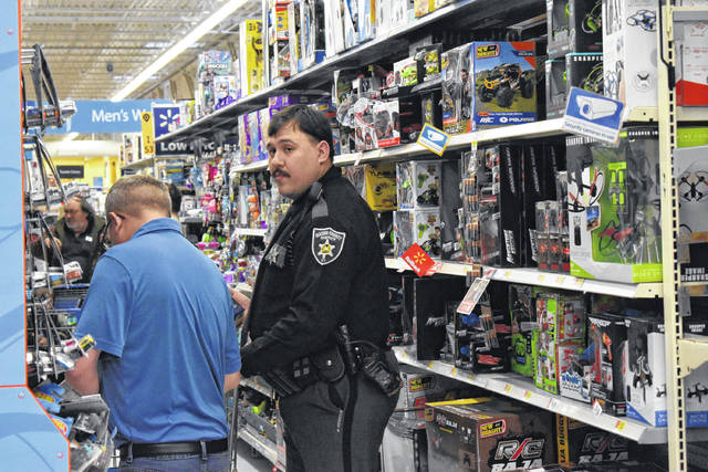 Deputies helped children and their parents pick out toys during Shop with a Cop.