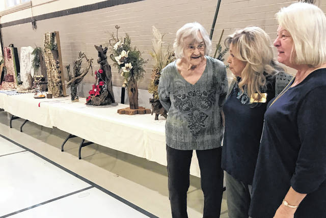 Judy Rigsby, Beverly Norman and Linda Blosser are pictured at the flower show.