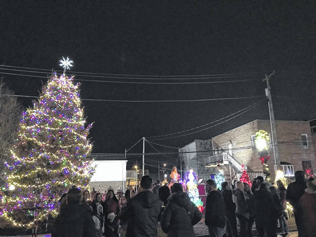 The rain and cool temperatures did not dampen the holiday spirits of those gathered for the City of Point Pleasant's annual Christmas parade and tree lighting ceremony Friday night. Following one of the year's largest parades, the switch was flipped at Gunn Park, lighting up not only the city's official Christmas tree but the trees for the Light of Christmas tree project which raises money for the Mason County Toys for Kids organization. Pictured are the moments following the tree lighting.