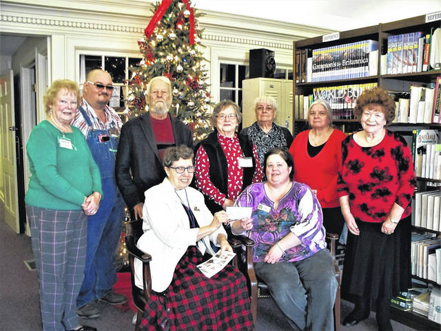Members of the Point Pleasant Writers Guild are pictured with Mason County librarian Amy Thompson.