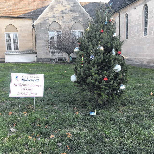 The Christ Episcopal Church welcomes anyone to place an ornament on the memory tree. The tree is located between the rectory and Episcopal Church. Members of the church decorate the tree with ornaments in memory of loved ones lost, and they are inviting everyone to share their loved ones' memories on the tree.