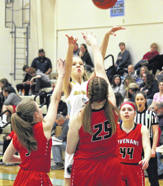 Ohio Valley Christian freshman Kirsten Groves attempts a shot in between a trio of Lady Eagles, during Covenant's 38-11 win on Friday in Gallipolis, Ohio.