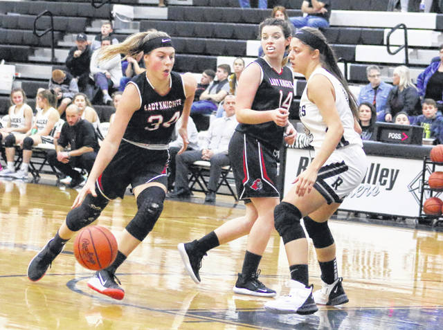Point Pleasant sophomore Tayah Fetty (34) dribbles past a River Valley defender as teammate Baylie Rickard looks on during the second half of Monday night's girls basketball game in Bidwell, Ohio.