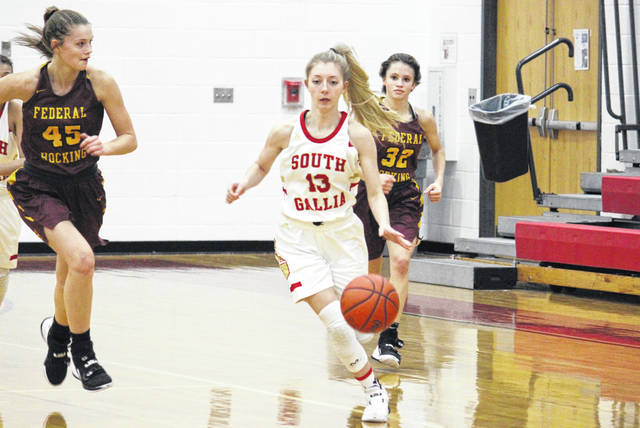 South Gallia senior Jaslyn Bowers (13) steals the ball and starts a fast break in front of Lady Lancers Emma Beha (45) and Paige Tolson (32), during the Lady Rebels' 20-point win on Monday in Mercerville, Ohio.