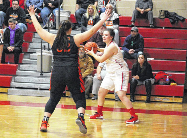 Wahama junior Victoria VanMatre, right, looks to make a pass from the corner during a Dec. 5, 2019, girls basketball contest against Belpre in Mason, W.Va.