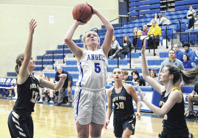 Gallia Academy junior Maddy Petro (5) tries a two-pointer in between a trio of Lady Pointers, during the Blue Angels' six-point setback on Thursday in Centenary, Ohio.