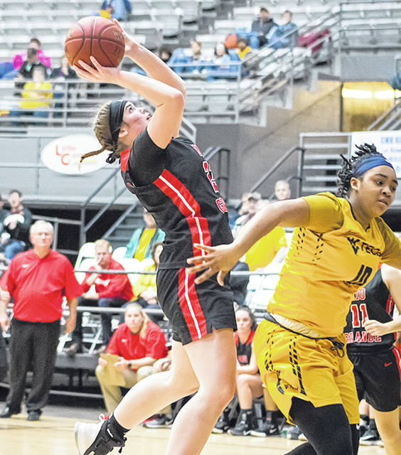 Rio Grande's Lexi Woods puts up a shot over WVU Tech's Alexandria Gray during the second half of Thursday night's River State Conference matchup at the Beckley-Raleigh County Convention Center. Woods scored a career-high 31 points, but the RedStorm dropped a 102-89 decision to the Golden Bears.
