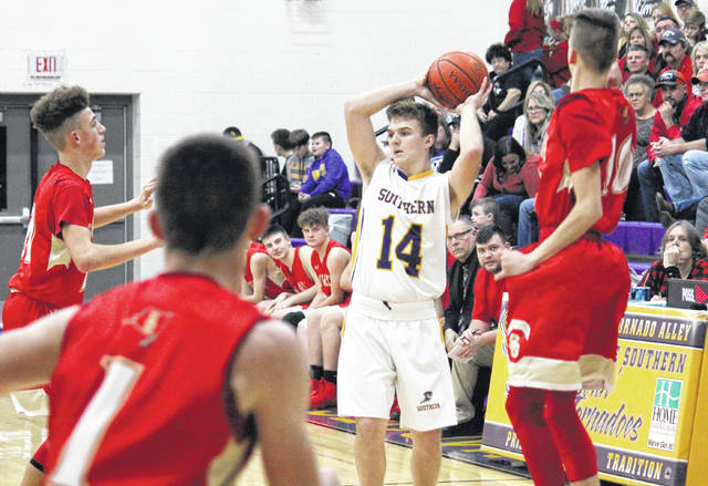 Southern senior Trey McNickle (14) passes out of a double team, during the Tornadoes' 47-45 victory on Friday in Racine, Ohio.