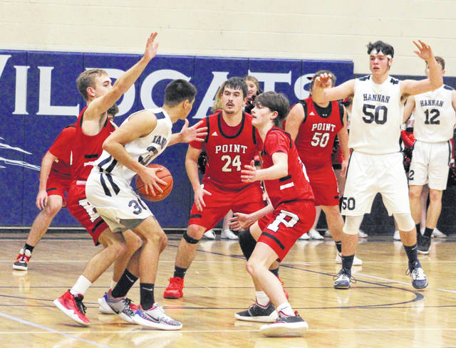 Point Pleasant defenders Aidan Sang, Braxton Yates (24) and Kyelar Morrow apply pressure to Hannan's Casey Lowery (30) during the first half of Friday night's boys basketball contest in Ashton, W.Va.