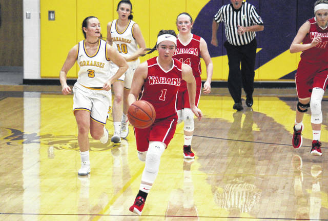 Wahama senior Hannah Rose (1) leads a fast break, during the Lady Falcons' 52-47 victory on Saturday in Racine, Ohio.
