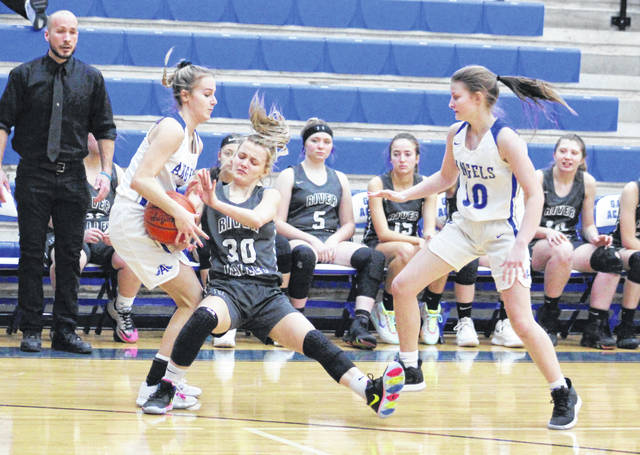 Gallia Academy senior Alex Barnes, left, rips the ball away from River Valley's Kaylee Gillman (20) as teammate Regan Wilcoxon (10) looks on during the second half of Monday night's girls basketball game in Centenary, Ohio.