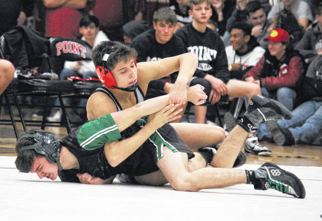 Point Pleasant junior Christopher Smith locks in a hold on a Winfield opponent during a 126-pound match held on Dec. 11, 2019, at The Dungeon in Point Pleasant, W.Va.