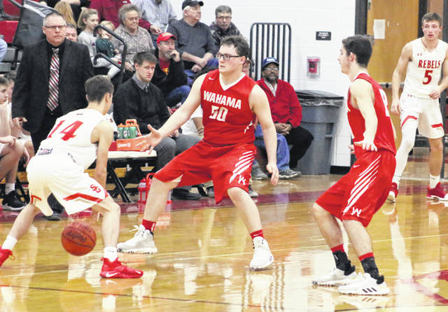 Wahama defenders Michael VanMatre (50) and Abram Pauley, right, trap South Gallia's Andrew Small during the second half of Tuesday night's boys basketball game in Mercerville, Ohio.