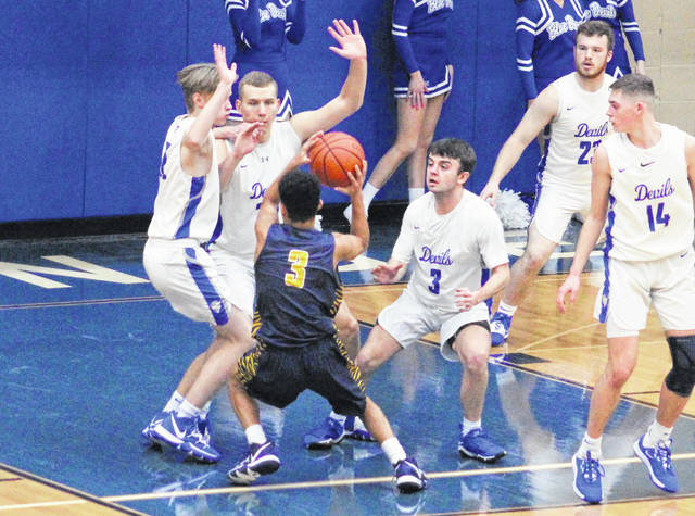 Gallia Academy defenders Reece Thomas, Damon Cremeens and Devin Lee, from left, surround a South Point player during the first half of Friday night's boys basketball contest in Centenary, Ohio.