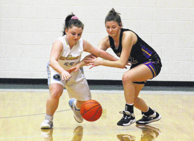 Ohio Valley Christian senior Marcie Kessinger, left, steals the ball away from an Ironton Saint Joseph player during the first half of Monday night's girls basketball contest in Gallipolis, Ohio.