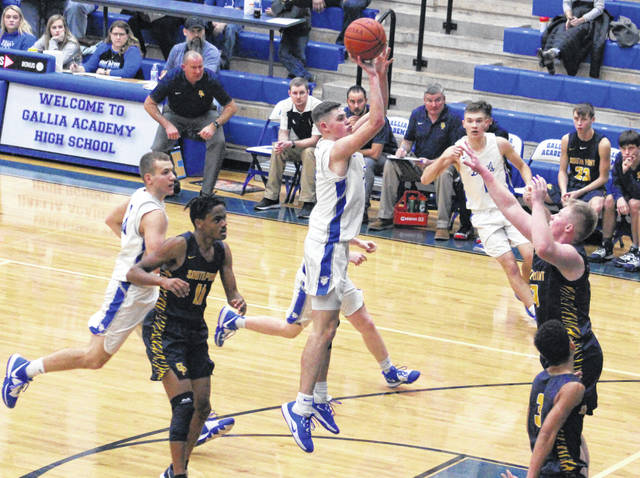 Gallia Academy senior Logan Blouir, middle, releases a shot attempt during a Jan. 24 boys basketball contest against South Point in Centenary, Ohio.