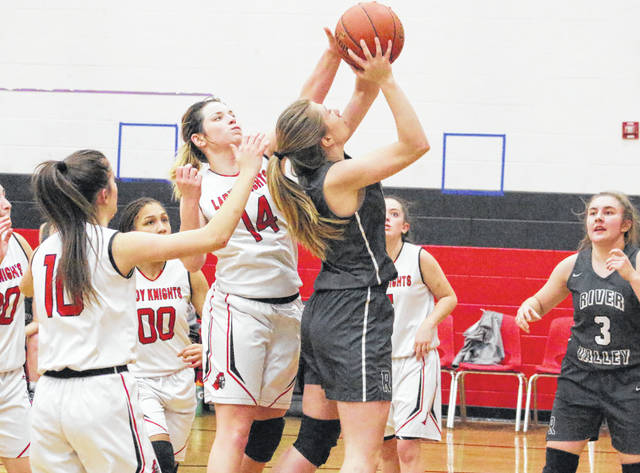 Point Pleasant sophomore Baylie Rickard (14) blocks a shot attempt during the second half of Thursday night's girls basketball game against River Valley in Point Pleasant, W.Va.
