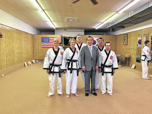 Pictured from left are Master Ted Siders, Master Pam Siders, Grandmaster S.H. Kang, Master James Lee, Master Dan Foglesong and Master Drew Foglesong.