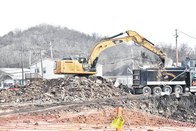 Demolition is continuing at the future site of the Point Pleasant River Museum and Learning Center. The crew is in the process of removing the debris from the first building, which was torn down last week. As seen in the bottom right corner of the photo, a hole remains where the building formerly stood.