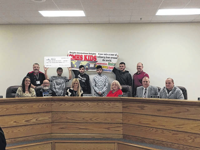 Pictured with board of education members and the superintendent are students in Stephen Richardson's drafting class at the Mason County Career Center. Also pictured, Steve Martin from Cabell Midland High School.