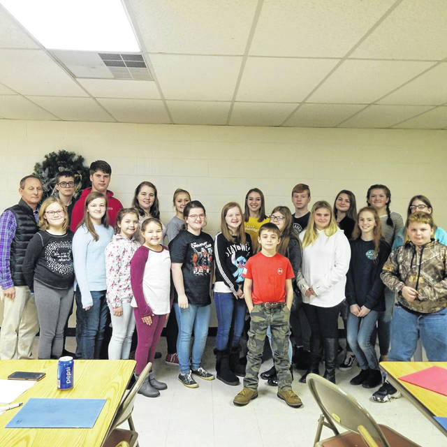 Haer Bears 4-H group members are pictured with Recycling Coalition Secretary Tom Aluise. The club won the champion prize.