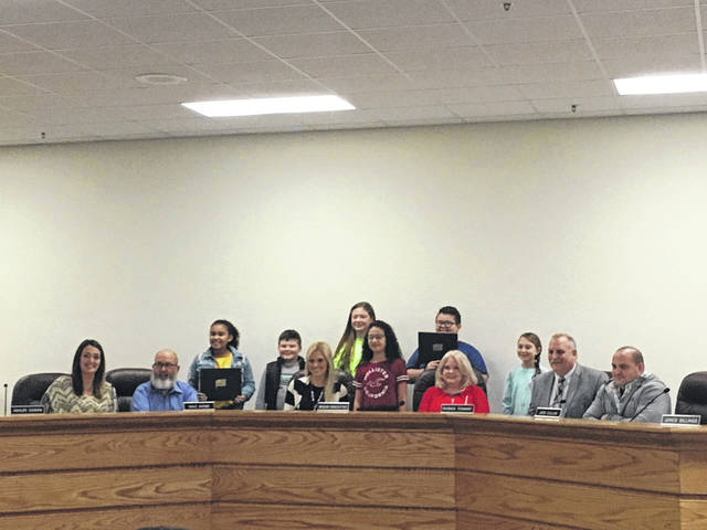 Students from New Haven's Student Council led the Pledge of Allegiance during the meeting on Tuesday evening.