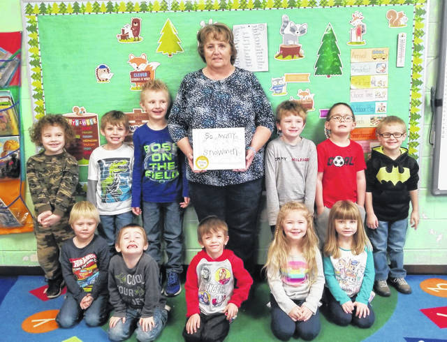 Jackie Corfee is pictured with the Leon Elementary Preschool students. The students wrote and illustrated a book and dedicated it to Corfee.