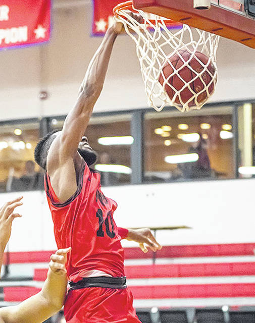 Rio Grande's Hadith Tiggs slams home two of his career-high 26 points in Tuesday night's 74-70 loss to Point Park University at the Newt Oliver Arena.