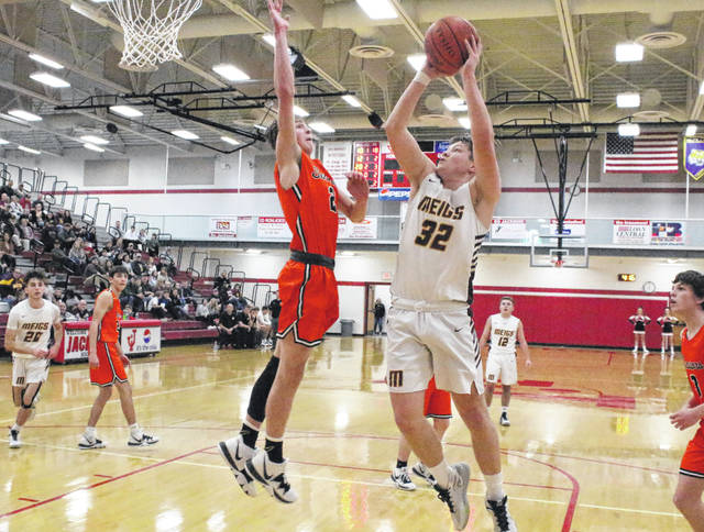 Meigs junior Wyatt Hoover (32) takes the ball to the basket while being approached by a Portsmouth West defender during the second half of Wednesday night's Division III sectional semifinal boys basketball contest at Jackson High School in Jackson, Ohio.