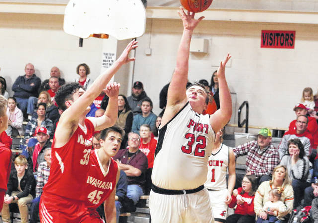 Point Pleasant senior McKeehan Justus (32) releases a shot attempt over a Wahama defender during the second half of Friday night's boys basketball contest in Point Pleasant, W.Va.