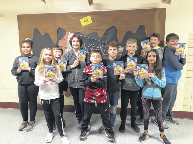 """This group of New Haven Elementary School students received a sneak peek of the book they will be reading for the second annual """"One School, One Book"""" project. The entire school, from students to teachers, bus drivers to cooks, will be reading """"The Chocolate Touch"""" and discussing the book during the month of March."""