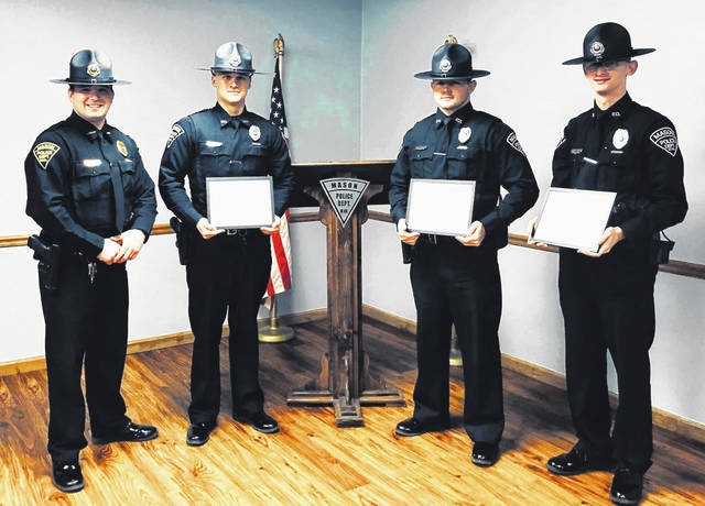 """Mason police officers were recently presented awards within the department for the efforts they have made during the past year. Pictured, from left, are Chief Colton McKinney; Patrolman Tyler Doss, who was named """"Officer of the Year""""; Patrolman Austen Toler, """"Criminal Enforcer Officer of the Year""""; and Patrolman Clayton Gibbs, """"Highway Safety Officer of the Year."""""""
