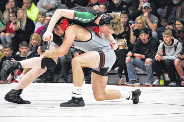 Point Pleasant junior Mitchell Freeman gains leverage on an 145-pound opponent during a Dec. 11, 2019, match against Winfield in Point Pleasant, W.Va.