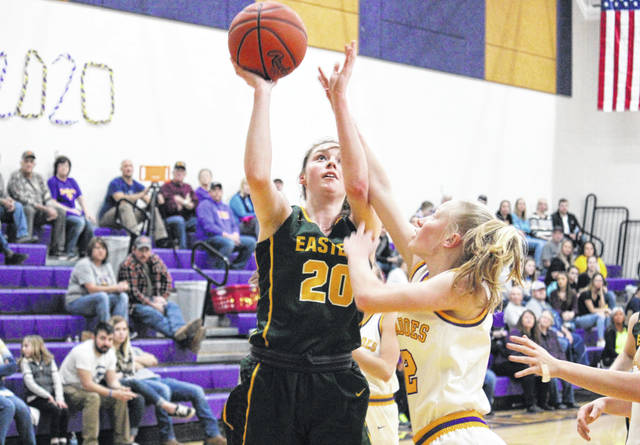 Eastern junior Olivia Barber (20) shoots a two-pointer over Southern sophomore Kayla Evans, during the Lady Eagles' 51-39 victory on Monday in Racine, Ohio.