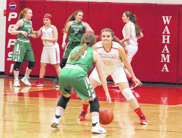 Wahama freshman Morgan Christian (31) applies defensive pressure to a Waterford player during the second half of Monday night's girls basketball contest in Mason, W.Va.