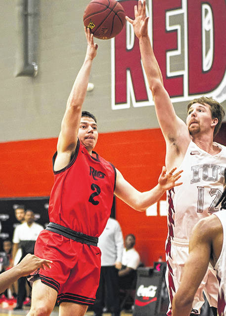 Rio Grande's Bobby Anderson lets go of a shot over the outstretched arms of Indiana University East's Keating Rombach during the first half of Tuesday night's game at Lingle Court in Richmond, Ind. The Red Wolves used a first half scoring spurt to build a big lead and hand the RedStorm a 79-57 loss.