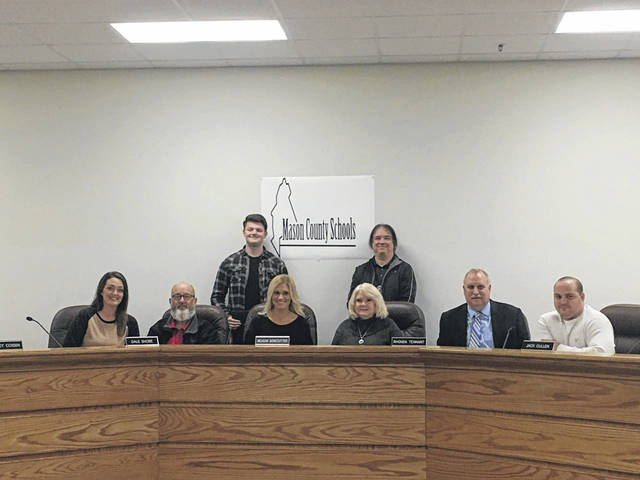Brady Sayre won the logo contest for Mason County Schools. His logo will be used in the future by the school district. Sayre is pictured in the back row, left, with his instructor Jeff Wamsley, right, and with the board of education members.