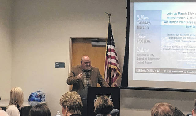 Larry Jones, from the Mason County Area Chamber of Commerce, addresses those in attendance at Tuesday's Chamber luncheon.