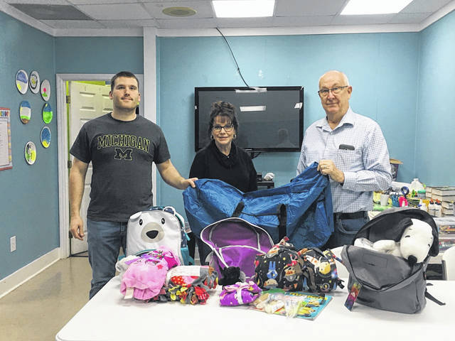 Pictured with the Comfort Care duffel bags and personalized backpacks are Pastor Jordan Decker, volunteer Debi Cottrill and Prevention Coalition Ronie Wheeler.