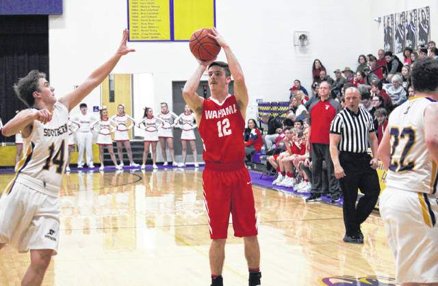Wahama senior Abram Pauley (12) fires a three-pointer over Southern senior Trey McNickle (14), during a Jan. 7 meeting in Racine, Ohio.