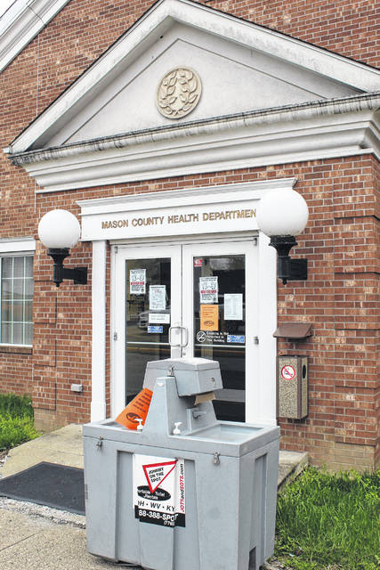 A hand washing station outside the Mason County Health Department on Tuesday afternoon, hours before the stay-at-home order was to go into effect.