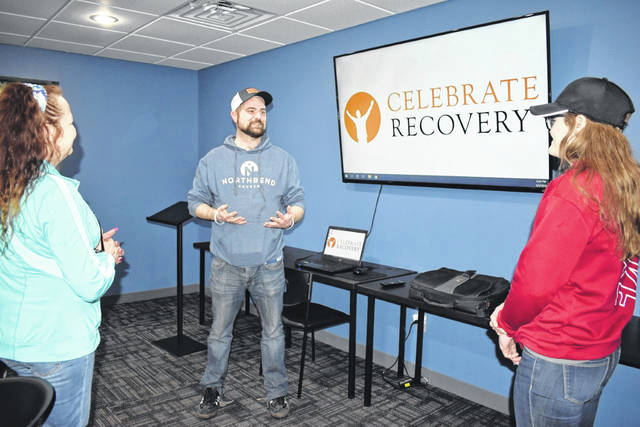 Celebrate Recovery, a national 12-step, Christ-centered recovery program, is set to relaunch in Mason on March 16 under the auspices of Northbend Church. The meetings will take place on Mondays at The Center, the former Mason Elementary School on Adams Street, at 6 p.m. Pictured is Buddy Shiltz, center, one of two ministry leaders, as he discusses the relaunch with others. (Mindy Kearns | Courtesy)
