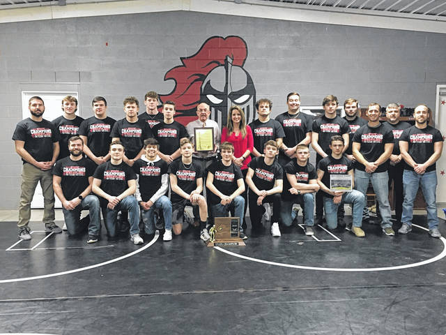 """Mayor Brian Billings, City Clerk Amber Tatterson and the Point Pleasant City Council are declaring Friday, March 6 as """"Point Pleasant High School Big Black Wrestling Day"""" in the City of Point Pleasant. Billings asked offices and businesses in the city to celebrate by decorating in red and black on Friday. The wrestling team won it's fifth Class AA-A championship this past weekend at the WVSSAC Championships in Huntington. The team won with 266.5 points, which defeated the entire class field by 155.5 points — a new state record for margin of victory. The team also boasts six individual state champions this year."""