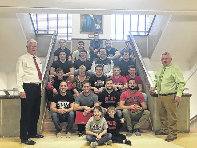 Mason County Commissioners honored the Point Pleasant High School Wrestling Team during their meeting on Thursday. Commissioners are pictured with the team and coaches.